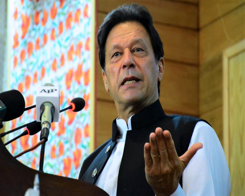 Pakistan's Prime Minister Imran Khan addresses the legislative assembly in Muzaffarabad, the capital of Pakistan-controlled Kashmir on August 5, 2020 AFP