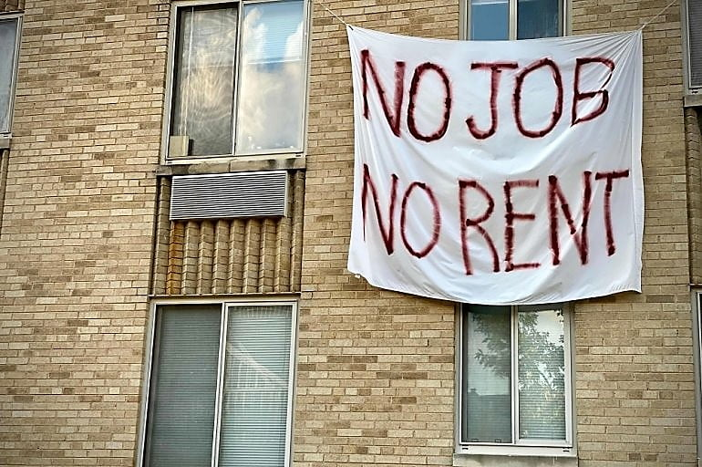 No job No Rent, a banner hanging on the building due to not any job in America