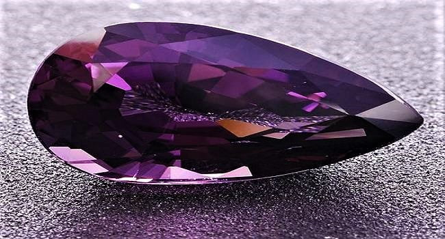 taaffeite is a mauve-hued gem made of magnesium and other elements